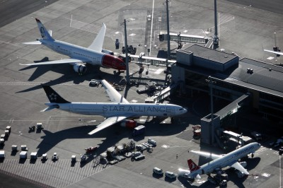 Planes docked at Oslo Airport's international terminal. Norwegian Air's rapid intercontinental expansion drew criticism from the Civil Aviation Authority after it discovered 21 serious regulatory breaches during an inspection in November. Customers lodged 29,000 complaints, mostly over cancellations and delays. Meanwhile, US airlines and unions lobbied authorities to ban Norwegian from flying to the States, arguing the carrier has breached an agreement by hiring cheaper Thai staff. PHOTO: Oslo Lufthavn AS