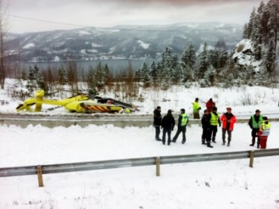 Two persons were killed and one man was seriously injured when a rescue helicopter landing at the scene of a traffic accident outside Oslo crashed itself. The accident occurred at Sollihøgda on the E16 highway. In the background, the Holsfjord and the hills north of Drammen. PHOTO: Marte Christensen / NTB Scanpix