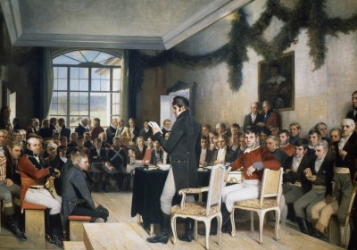 """Oscar Wergeland's famous painting of the gathering in Eidsvoll that expanded from the original meeting of 21 men on February 16, 1814 to the one that approved Norway's Constitution (""""Grunnloven"""") on the 17th of May. ILLUSTRATION: Stortinget"""
