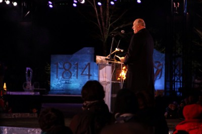 """King Harald speaking on the grounds of the historic """"Eidsvollsbygning,"""" as festivities got officially underway to mark the 200th anniversary of Norway's Constitution. PHOTO: Statsministerens kontor"""