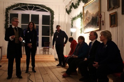 On Sunday evening, Prime Minister Erna Solberg (right), her husband and members of the government and Parliament were given a guided tour of the newly restored former home of Carsten Anker in Eidsvoll where Norway's Constitution was written and approved. Solberg had just returned from several days at the Winter Olympics in Sochi. PHOTO: Statsministerens kontor