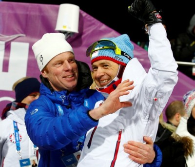 Norwegian biathlon legend Ole Einar Bjørndalen (right) was congratulated by, among other, Norwegian skiing legend Bjørn Dæhlie after winning another gold medal on Saturday at the age of 40. The victory tied Dæhlie's record for claiming the most Olympic medals. PHOTO: Heiko Junge / NTB Scanpix