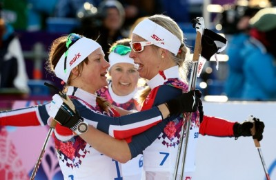Norway's Maiken Caspersen Falla (left) both celebrated and cried with her teammates, second placed Ingvild Flugstad Østberg (center) and Astrid Uhrenholdt Jacobsen (right) after Falla won gold in the women's cross-country sprint free final at the Sochi 2014 Winter Olympic. Østberg won silver and Jacobsen, whose brother died on Friday, plunging the entire team into mourning, placed fourth. Jacobsen had wanted them all to ski despite her loss. They did, and they won.  PHOTO: REUTERS/Sergei Karpukhin/NTB Scanpix
