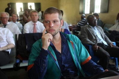 Defendant and convict Joshua French listens while his sentence was being read in the court in Kinshasa on Wednesday. In the background at far left, diplomat Kai Eide, who has been trying to get French pardoned or transferred to a prison in Norway. PHOTO: John Bompengo / NTB Scanpix