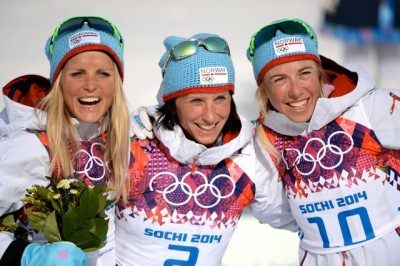 Norway's Marit Bjørgen (center), now the most-winning female Winter Olympian of all time, celebrated her sixth Olympic gold medal with teammates Therese Johaug (left) who won silver and Kristin Størmer Steira, who won bronze in the tough 30-kilometer race at their last competition in Sochi on Saturday. PHOTO: Wang Song/Xinhua/Sipa USA/NTB Scanpix