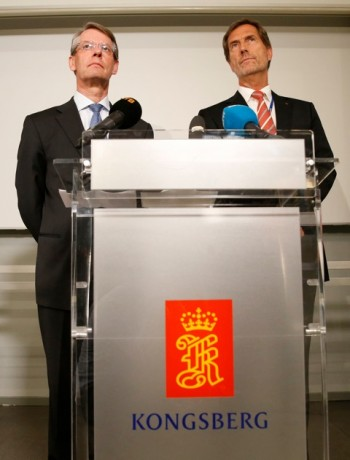 Kongsberg's leaders facing reporters in Oslo on Tuesday evening: Chairman Finn Jebsen (left) and Chief Executive Walter Qvam (right), who admitted management had been tipped about possible corruption tied to the company's contracts in Romania. Qvam said their own investigation was inconclusive and they decided last fall against pursuing the suspicions, which they did not share with the authorities, any further. Both men were surprised when Norway's economic crimes unit showed up at Kongsberg's offices. PHOTO: Cornelius Poppe/ NTB Scanpix