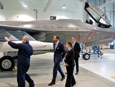 inspecting fighter jets at Lockheed Martin in Texas, 2013