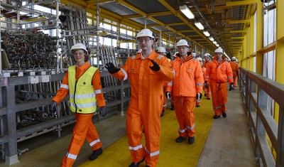 Labour Minister Robert Eriksson, shown here during a recent visit to an offshore installation, is being called upon to crack down on the exploitation of foreign workers in Norway. PHOTO: Arbeidsdepartementet/Kjetil Alsvik/ConocoPhillips