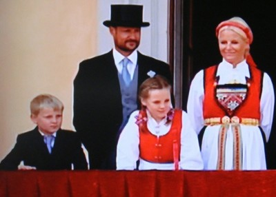 Crown Prince Haakon and Crown Princess Mette-Marit, shown here on the palace balcony last month with their two children, are being criticized for opting to put their children in private schools. PHOTO: NRK screen grab/newsinenglish.no