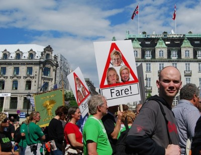 """Defiant Norwegian farmers marched through Oslo on Tuesday and demonstrated in front of the Parliament, over the government ministers' proposals for agricultural reforms. Sylvi Listhaug's photo was among those appearing on their signs claiming she, Prime Minister Erna Solberg and Finance Minister Siv Jensen are """"dangerous."""" PHOTO: newsinenglish.no/Nina Berglund"""