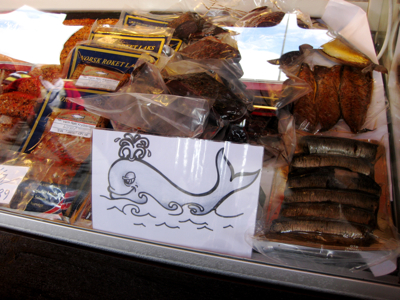 Whale meat on sale at Bergen's famous harbourside fish markets. The annual hunt is underway again for the summer, and the Fisheries Minister Elisabeth is investigating exporting Norwegian whale to Japanese markets. Local processors said it would be a politically unpopular move, and with local demand falling argued the golden days of Norwegian whaling have ended. PHOTO: Emily Woodgate/newsinenglish.no