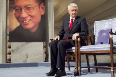 Nobel Committee Chairman Thorbjørn Jagland with the empty chair where Liu Xiaobo would have sat if the Chinese authorities had allowed him to receive his Nobel Peace Prize in December 2010. Now the empty chair will itself be the centerpiece of an exhibit honouring Liu at the Nobel Peace Center. PHOTO: Heiko Junge / NTB Scanpix/Nobel Peace Center