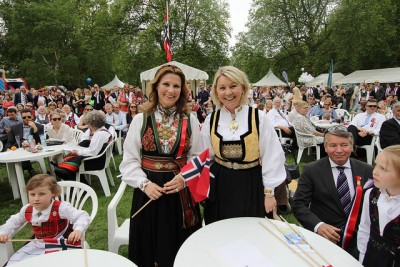 Princess Martha Louise (left) posed with Norway's trade minister, Monica Mæland, on the 17th of May in London. Now the princess is moving home to Norway with her family, and already stirring up criticism. PHOTO: Nærings- og fiskeridepartementet