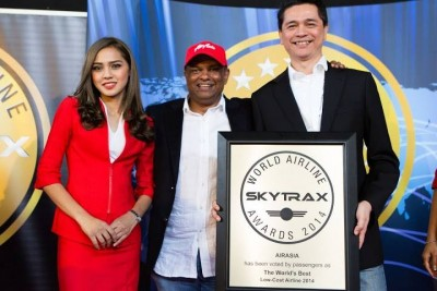 Fresh from the success of being named the world's best low cost airline for the 6th consecutive year in the annual Skytrax World Airline Awards, AirAsia founder Tony Fernandes (centre) said he would take on Norwegian Air and begin budget Asia to Scandinavia routes. PHOTO: AirAsia