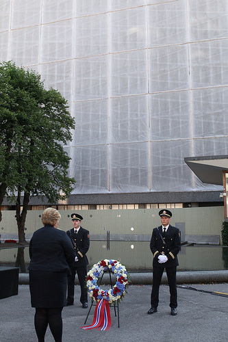 Prime Minister Erna Solberg pays her respects to the victims of the July 22 attacks in 2011 at the site of the bombed government headquarters in Oslo. PHOTO: Statsministerens kontor