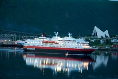 Hurtigruten, shown here gliding into port in Tromsø, is an important Norwegian asset that was sold to a British investment company last fall. They're promising more capital, however, for expansion. PHOTO: newsinenglish.no