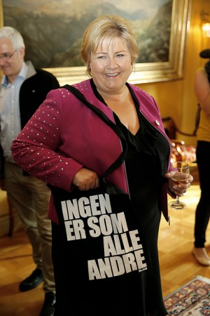 "Prime Minister Erna Solberg, shown here while hosting a reception during Gay Pride celebrations in Oslo in June, has enjoyed personal popularity. Her bag reads ""No one is like everyone else."" PHOTO: Statsministerens kontor"