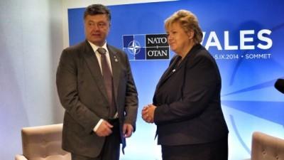 Prime Minister Erna Solberg meeting with Ukrainian President Petro Porosjenko at the NATO Summit in Wales. PHOTO: Statsministerens kontor