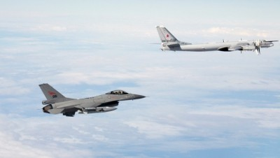 """The Norwegian department of defense released this photo, among others, of a Norwegian F16 fighter jet (at left) flying up to a Russian jet, to identify and document the so-called """"visit."""" PHOTO: Forsvaret"""