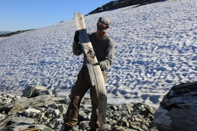 One of the archaeologists on the team from Oppland County, Runar Hole, displays the 1,300-year-old ski found last summer. PHOTO: Oppland County