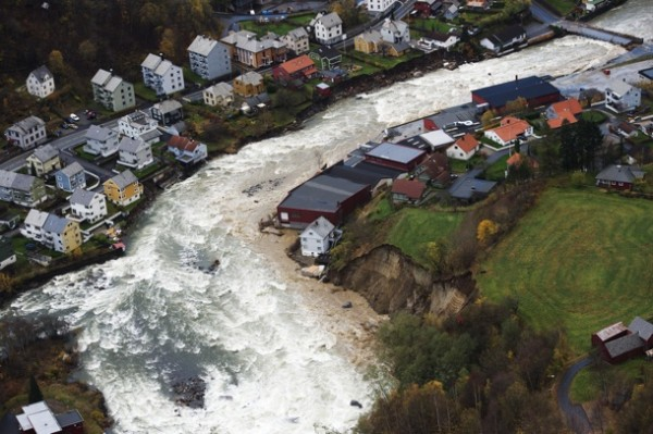 Violent flooding has caused chaos and destruction in west Norway. In the small town of Odda, the Opo river washed awaty homes and bridges. PHOTO: NTB Scanpix