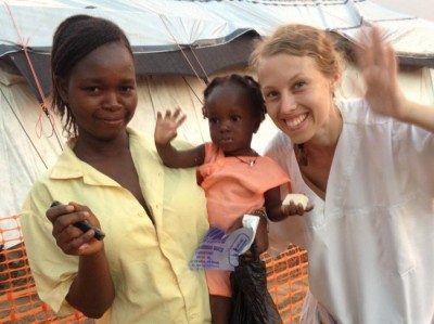 Leger uten grensen (Doctors without borders) released this photo on Monday of their colleague Dr Silje Lehne Michalsen before she became ill, while working in Sierra Leone. The little girl in the photo had tested negative for ebola. PHOTO: Leger uten grenser