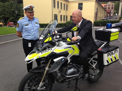 Justice Minister Anders Anundsen of the Progress Party, shown here checking out a new police motorcycle, has been keen to support the police. He was expected to approve a request by Police Director Odd Reidar Humlegård (left) to let police be armed at all times. PHOTO: Justis- og beredskapsdepartementet