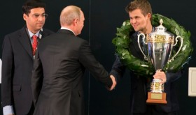 Russian President Vladimir Putin congratulated Chess World Champion Magnus Carlsen on Tuesday, as challenger Vishy Anand looked on at left. PHOTO: NTB Scanpix/Berit Roald
