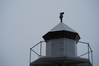 Legal surveillance cameras, like this one mounted on a lighthouse at Aker Brygge, are a common sight in Oslo. Uproar continues, however, over the reported presence of false base stations that can illegally tap into mobile phones. PHOTO: newsinenglish.no staff