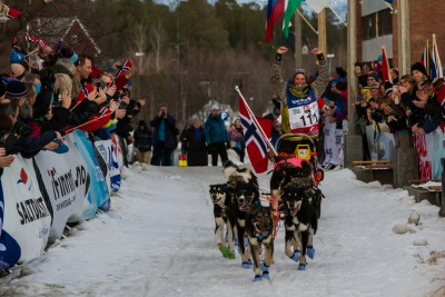 Sigrid Ekran crossing the finish line of the Finnmark  dogsled race, and winning for the second year in a row. PHOTO: Finnmarksløpet 2015