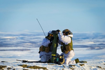 """Norway has been conducting its biggest military exercise in Northern Norway since the mid-1960s, even though Russia isn't believed to pose a threat to Norway. Here, soldiers from the 2nd Battalion secure equipment during this week's winter exercise """"Joint Viking 2015"""" in Finnmark. PHOTO: Forsvaret/Ole Sverre Haugli"""