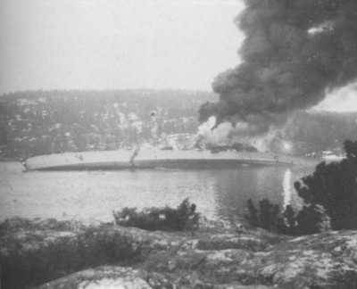 "Norwegian defense forces fired on the German heavy cruiser ""Blücher"" as it sailed up the Oslo Fjord on April 9, 1940, sinking it and hindering the German invasion enough that it gave time for the government and royal family to flee the Nazis. PHOTO: Forsvaret"