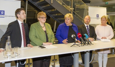 The leaders of the minority government coalition's support parties (from left, Knut Arild Hareide of the Christian Democrats and Trine Schei Grande of the Liberals) forced Prime Minister Erna Solberg (center) to make it easier for long-term asylum children to stay in Norway with their parents, even in cases where the parents don't meet asylum requirements. At right, Finance Minister Siv Jensen and Justice Minister Anders Amundsen, both from the Progress Party, which had to compromise the most. PHOTO: Justis- go beredskapsdepartementet
