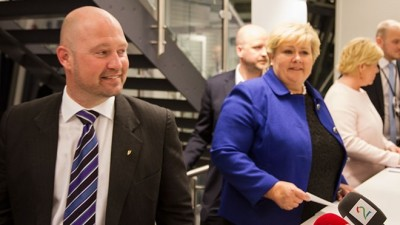 """Justice Minister Anders Amundsen of the Progress Party (left) and Prime Minister Erna Solberg of the Conservatives were all smiles when announcing the so-called """"asylbarn"""" solution this week. In reality, though, they had to give in to the more liberal asylum policies of their smaller support parties in Parliament, the Christian Democrats and the Liberals. PHOTO: Justis- go beredskapsdepartementet"""