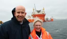 The long-troubled oil platform Goliat loomed behind Oil Minister Tord Lien and International Energy Agency director Maria van der Hoeven, after it finally arrived in Hammerfest, Northern Norway, earlier this month. PHOTO: Olje- og energi Departementet