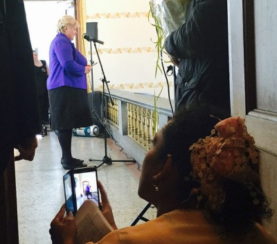 "Prime Minister Erna Solberg apologized in April for what her office called the ""racist and exclusionary"" policies directed at Romani people both before and after World War II. In the foreground a Roma woman captures Solberg's speech on video. PHOTO: Statsministerens kontor"