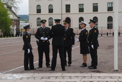 Norway's open society and an efficient police force, shown here in dress uniform on the 17th of May, are cited among the reasons for the country's low murder rate. PHOTO: newsinenglish.no