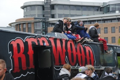 """""""Russ"""" partying around their elaborately decorated buses during an outdoor gathering Sunday at Filipstad in Oslo. PHOTO: newsinenglish.no"""