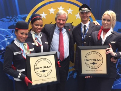 Norwegian Air's founder and chief executive Bjørn Kjos (center) posed with airline crew at the Paris Air Show this week after winning two top awards. The awards encouraged Kjos, who admitted the airline's long-haul service has been too troubled. PHOTO: Norwegian Air