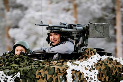 NATO Chief Jens Stoltenberg posing in a tank when he was still prime minister of Norway, in 2012. PHOTO: Forsvaret/Torbjørn Kjosvold