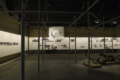 Among the displays is a detailed timeline of the sequence of events on July 22, 2011, including the damaged clock that adorned an historic building nearby. At right, the charred remains of the van that carried the bomb that devastated Norway's government complex. PHOTO: Kommunal-og moderniseringsdepartementet