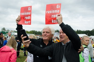 """Frode Kyvåg (left) gladly posed for a """"selfie"""" with the Labour Party's candidate to lead Oslo's city government, Raymond Johansen, during an anti-racism demonstration at Norway Cup last week. Now Kyvåg is launching a political career himself. PHOTO: Arbeiderpartiet"""
