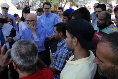 Vidar Helgesen, chief of staff for Prime Minister Erna Solberg, was visibly moved by the problems faced by refugees in Greece. Helgesen (center left, in blue shirt) promised more aid then and it's coming now.  PHOTO: Utenriksdepartementet