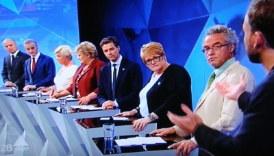 Leaders of Norway's political parties listen to Audun Lysbakken of the Socialist Left (SV) make a point during NRK's live televised election debate Monday evening. From left: Trygve Slagsvold of the Center Party, Jonas Gahr Støre of Labour, Finance Minister Siv Jensen of the Progress Party, Prime Minister Erna Solberg of the Conservatives, Knut Arild Hareide of the Christian Democrats, Trine Skei Grande of the Liberals and Rasmus Hansson of the Greens. PHOTO: NRK screen grab/newsinenglish.no
