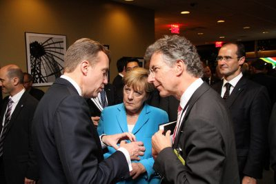 Norway continues to be heard by other world leaders, like here when Brende met German Chancellor Angela Merkel at the UN, but calls are going out for firmer strategy and priorities. At right, foreign policy advisder Christoph Heusgen. PHOTO: Utenriksdepartementet