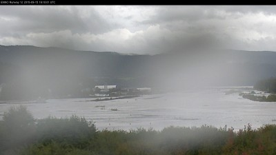 The Notodden Airport's webcam offered this photo of the flooding on Tuesday afternoon, blurred by rain on the lens. PHOTO: Notodden flyplass