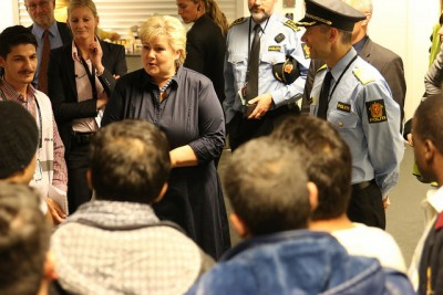 Prime Minister Erna Solberg, shown here meeting refugees in Oslo earlier this month, has outlined her plan for covering the unexpected costs of the refugee influx. They may hit NOK 85 billion (USD 10 billion) over the next six years. PHOTO: Statsministerens kontor