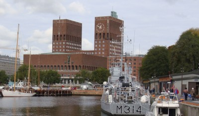 Oslo's City Hall was once again ready to host the annual Nobel Peace Prize ceremony on Thursday. In the foreground, an historic military vessel berthed below Norway's Akershus Fortress, where Norwegian military chiefs are evaluating a request from the US for more help in the war against IS in Syria and Iraq. PHOTO: newsinenglish.no
