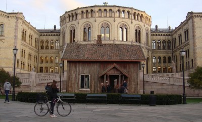 A 150-year-old wooden house that was placed in front of Norway's Parliament as part of an art project last fall will now be saved and rehabilitated. PHOTO: newsinenglish.no
