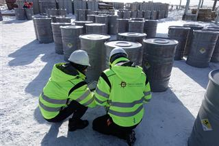 Workers from the Norwegian Radiation Protection Authority verifying the contents of natural uranium bound for Iran. PHOTO: Statens strålevern